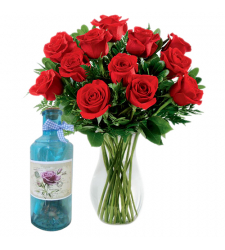 12 red roses in vase with bottle message