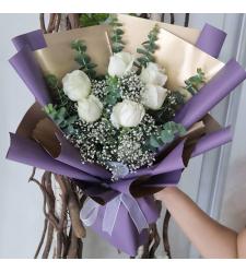 send half dozen white color roses in bouquet to cebu