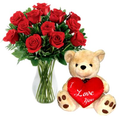 send 12 red roses vase with bear to  cebu